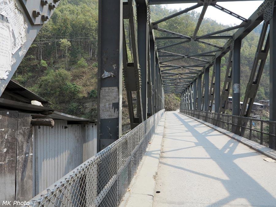 Автомобильный мост через р. Тама Коши
